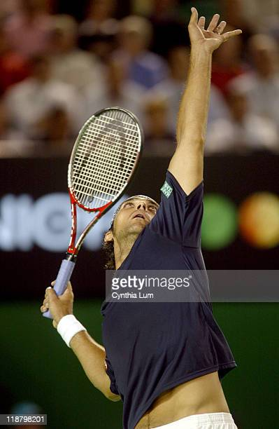 Mark Philippoussis serves during his first match against Sebastian Grosjean in the Ausralian Open at Melbourne Park on January 17 2006 Match Ongoing