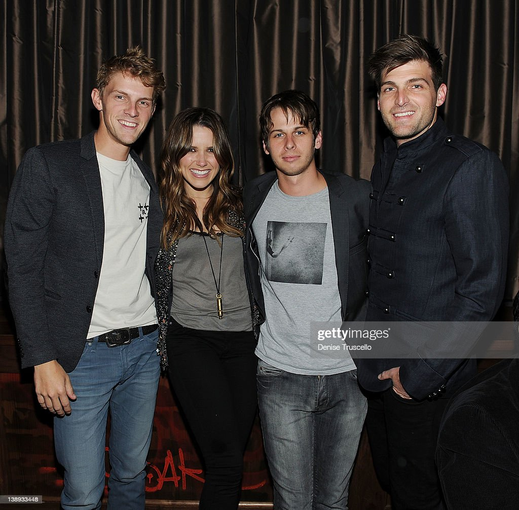 Mark Pontius Mark Foster and Cubbie Fink of the musical group Foster The People pose for a photo with Sophia Bush at Marquee Nightclub at The...