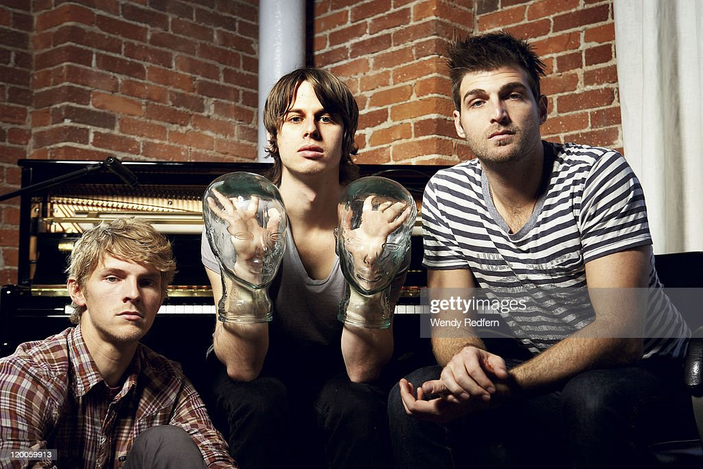 Mark Pontius Mark Foster Cubbie Fink of Foster the People pose for a group portrait on February 10 2011 in Los Angeles California United States