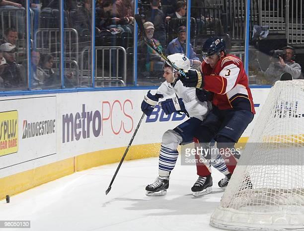 Mark Popovic of the Atlanta Thrashers checks Wayne Primeau of the Toronto Maple Leafs at Philips Arena on March 25 2010 in Atlanta Georgia