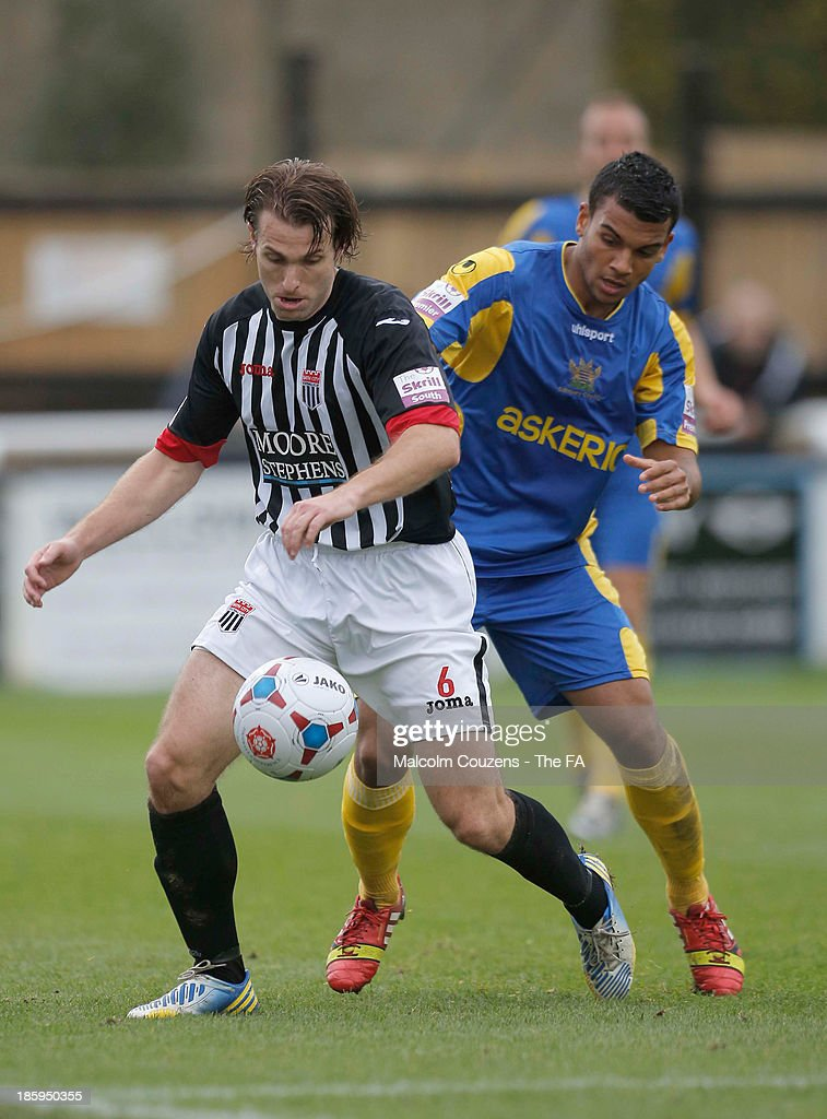 Mark Preece of Bath City (L) and Theo Lewis of Salisbury compete for the ball during the FA Cup fourth qualifying round match between Bath City and Salisbury at Twerton Park on October 26, 2013 in Bath, England.