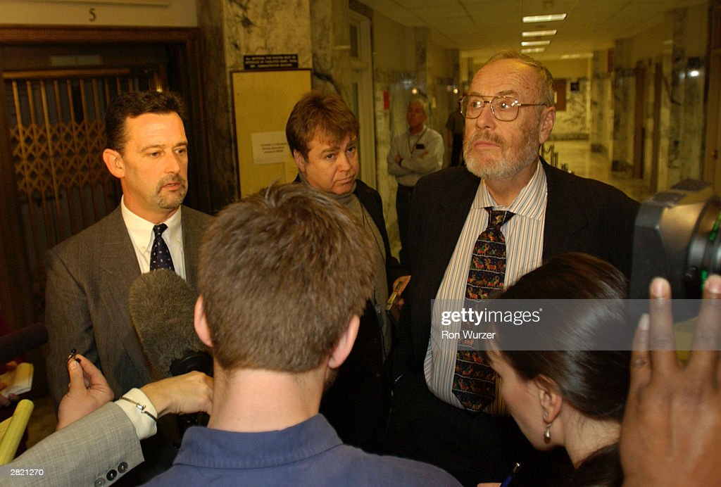 Mark Prothero (L) and Anthony Savage (R), lawyers for convicted mass murderer Gary Ridgway, known as the Green River Killer, speak with the media December 18, 2003 in Seattle, Washington. Ridgway was sentenced to life in prison without the chance of release in King County Superior Court.