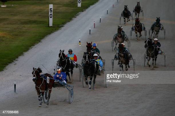 Mark Purdon driving Follow The Stars wins the Breckon Farms Young Guns Final during the 2014 Auckland Trotting Cup at Alexandra Park on March 7 2014...