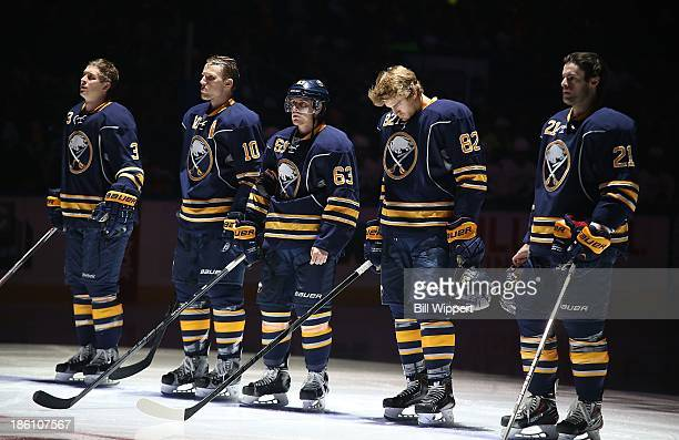 Mark Pysyk Christian Ehrhoff Tyler Ennis Marcus Foligno and Drew Stafford of the Buffalo Sabres stand for the anthems before playing the Vancouver...