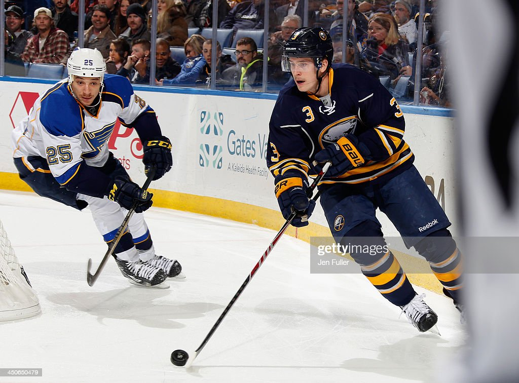 <a gi-track='captionPersonalityLinkClicked' href=/galleries/search?phrase=Mark+Pysyk&family=editorial&specificpeople=6571526 ng-click='$event.stopPropagation()'>Mark Pysyk</a> #3 of the Buffalo Sabres carries the puck against Chris Stewart #25 of the St. Louis Blues at First Niagara Center on November 19, 2013 in Buffalo, New York. St. Louis defeated Buffalo 4-1.