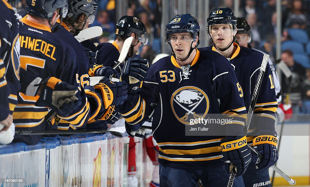 Mark Pysyk #53 of the Buffalo Sabres celebrates his first NHL goal with teammates along the bench in their game against the New York Rangers at First Niagara Center on April 19, 2013 in Buffalo, New York.