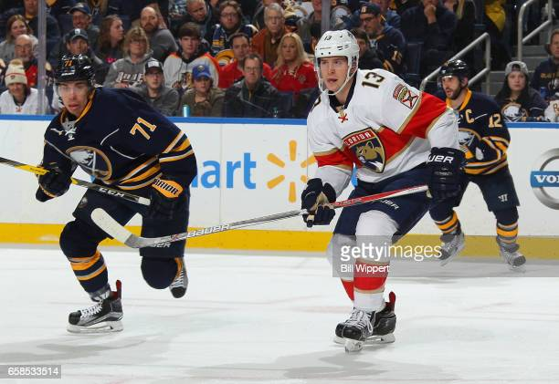Mark Pysyk of the Florida Panthers playing in his 200th career NHL game skates against Evan Rodrigues of the Buffalo Sabres at the KeyBank Center on...