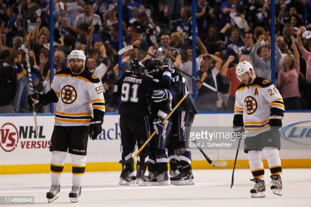Mark Recchi and Johnny Boychuk of the Boston Bruins reacts as the Tampa Bay Lightning celebrate a third period goal by Martin St Louis of the Tampa...