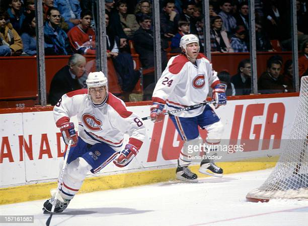 Mark Recchi and Lyle Odelein of the Montreal Canadiens skate in a game at the Montreal Forum circa 1990 in Montreal Quebec Canada