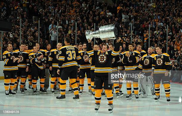 Mark Recchi of the Boston Bruins hoists the cup for the crowd before the game against the Philadelphia Flyers at the TD Garden on October 6 2011 in...