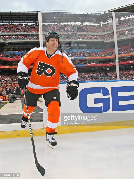 Mark Recchi of the Philadelphia Flyers enters the rink during player introductions before his game against the New York Rangers during the Alumni...