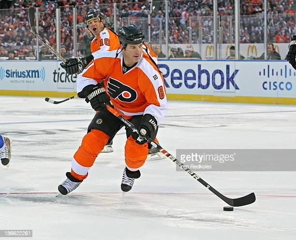 Mark Recchi of the Philadelphia Flyers skates the puck against the New York Rangers during the Alumni Game prior to the 2012 NHL Bridgestone Winter...
