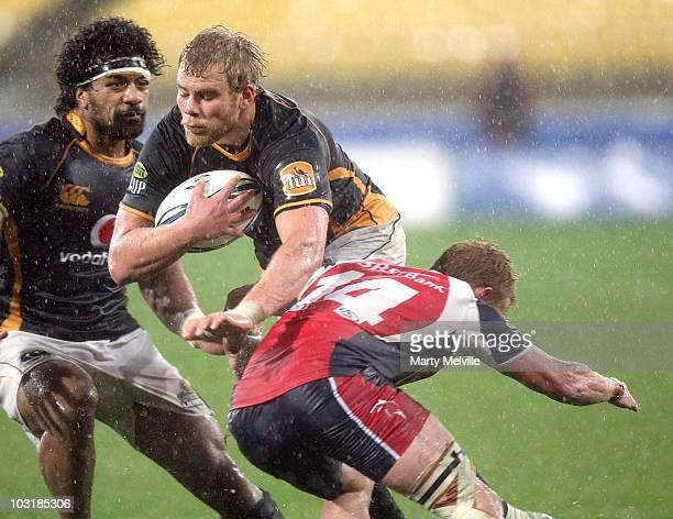 Mark Reddish of the Lions is tackled by Blair Cook of Tasman during the round one ITM Cup match between Wellington and Tasman at Westpac Stadium on...
