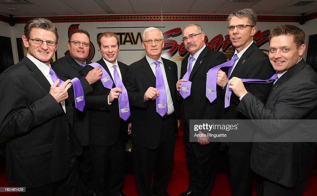 Mark Reeds, Rick Wamsley, Jordan Silmser, Bryan Murray, Paul MacLean, Dave Cameron and Tim Pattyson of the Ottawa Senators pose with purple ties on Hockey Talks night, in support of Do It For Daron (D.I.F.D.), prior to a game against the Toronto Maple Leafs on February 23, 2013 at Scotiabank Place in Ottawa, Ontario, Canada.