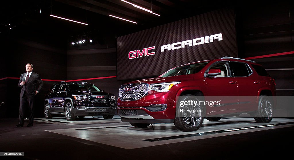 Mark Reuss General Motors Executive Vice President of Global Product Development reveals the 2017 GMC Acadia crossover SUV to the news media at the...