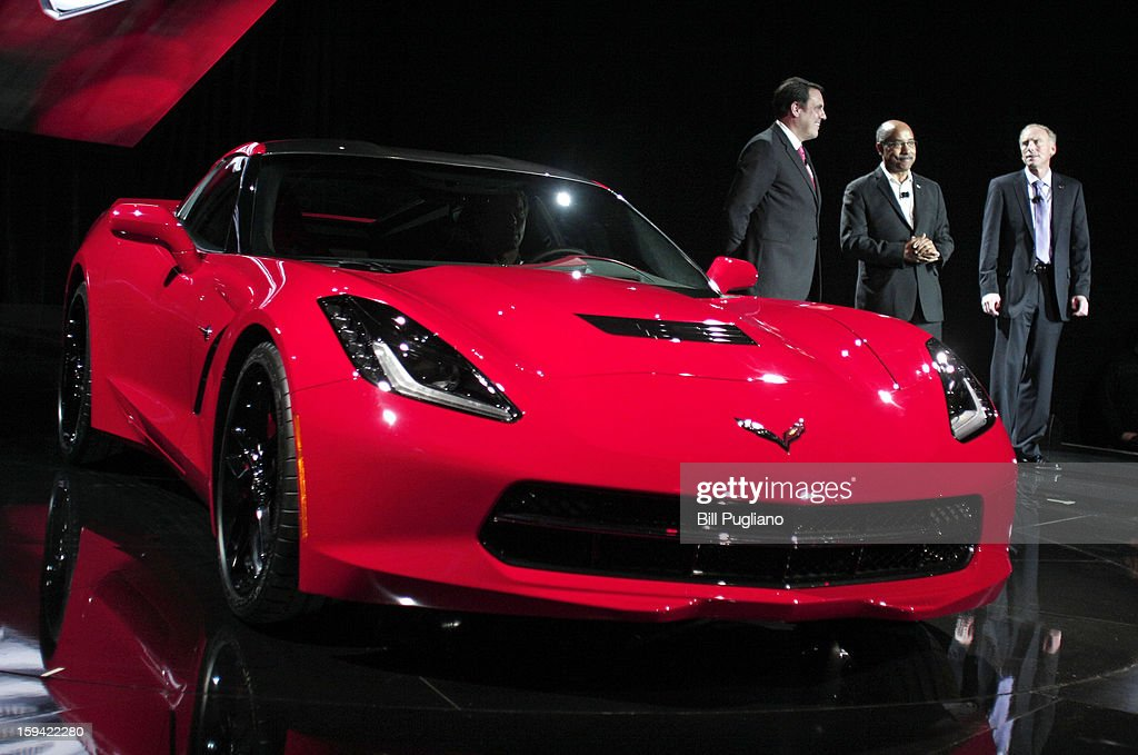 Mark Reuss (L), General Motors' President of North America, Ed Welburn (C), Vice President of Global Design, and Tadge Juenter, Corvette Chief Engineer, stand with the 7th-generation Chevrolet Corvette, the C7, during its reveal to the media at the Russell Industrial Complex January 13, 2013 in Detroit, Michigan. The redesigned 2014 Corvette was revealed at a preview of the 2013 North American International Auto Show, which opens in Detroit January 14th.