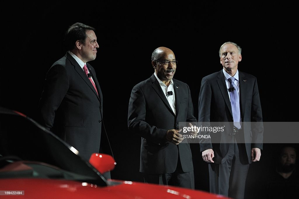 Mark Reuss (L), President of GM North America, Ed Welburn (C), GM Vice President of Global Design, Tadge Juechter (R), Corvette Executive Chief Engineer, introduce the redesigned 2014 Chevrolet Corvette, the night before press previews start at the 2013 North American International Auto Show in Detroit, Michigan, January 13, 2013. AFP PHOTO/Stan HONDA