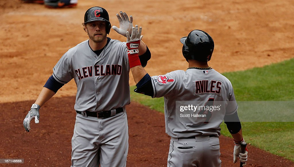 <a gi-track='captionPersonalityLinkClicked' href=/galleries/search?phrase=Mark+Reynolds&family=editorial&specificpeople=2343799 ng-click='$event.stopPropagation()'>Mark Reynolds</a> #12 (L) and Mike Aviles #4 of the Cleveland Indians celebrate after Reynolds hits a home run in the seventh inning against the Houston Astros at Minute Maid Park on April 21, 2013 in Houston, Texas.