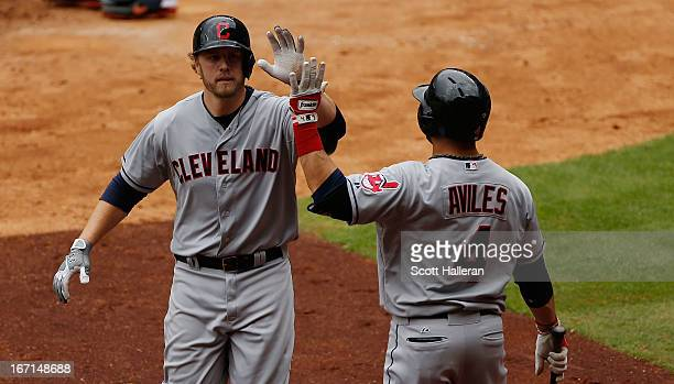 Mark Reynolds and Mike Aviles of the Cleveland Indians celebrate after Reynolds hits a home run in the seventh inning against the Houston Astros at...