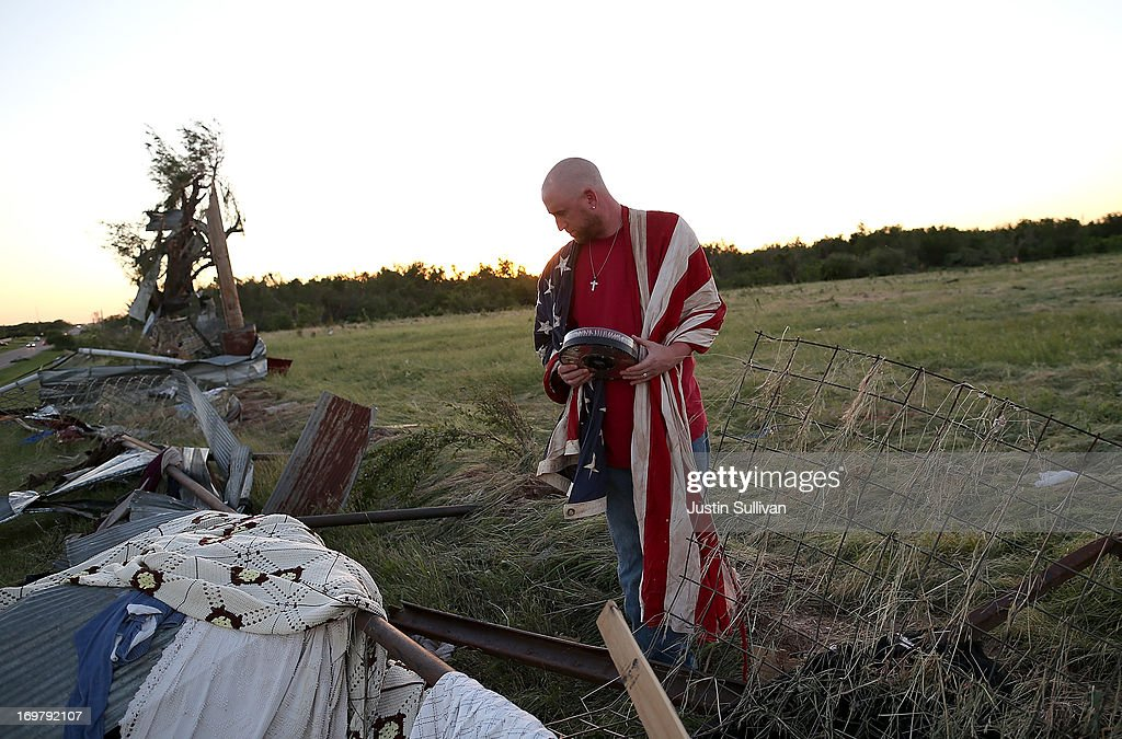 Mark Reynolds looks through debris to find personal items after a series of tornadoes that ripped through the area a day earlier on June 1, 2013 in El Reno, Oklahoma. A series of tornadoes ripped through the area on Friday evening killing at least nine people, injuring many others and destroying homes and buildings.