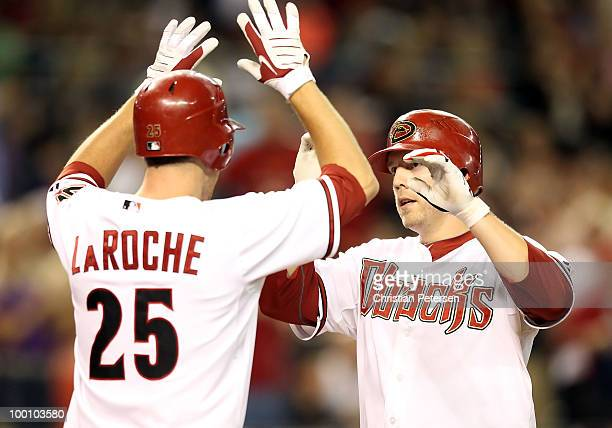Mark Reynolds of the Arizona Diamondbacks is congratulated by teammate Adam LaRoche after Reynolds hit a 2 run home run against the San Francisco...