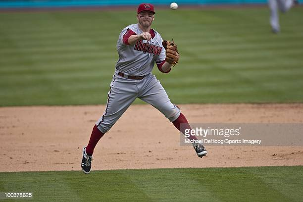 Mark Reynolds of the Arizona Diamondbacks throws to first base during a MLB game against the Florida Marlins in Sun Life Stadium on May 18 2010 in...