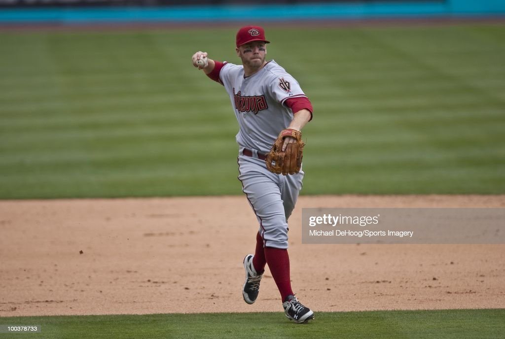 Mark Reynolds #27 of the Arizona Diamondbacks throws to first base during a MLB game against the Florida Marlins in Sun Life Stadium on May 18, 2010 in Miami, Florida.