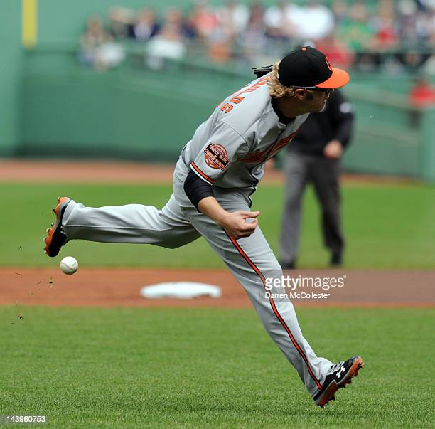 Mark Reynolds of the Baltimore Orioles fumbles a ground ball in the first inning against the Boston Red Sox at Fenway Park on May 6 2012 in Boston...