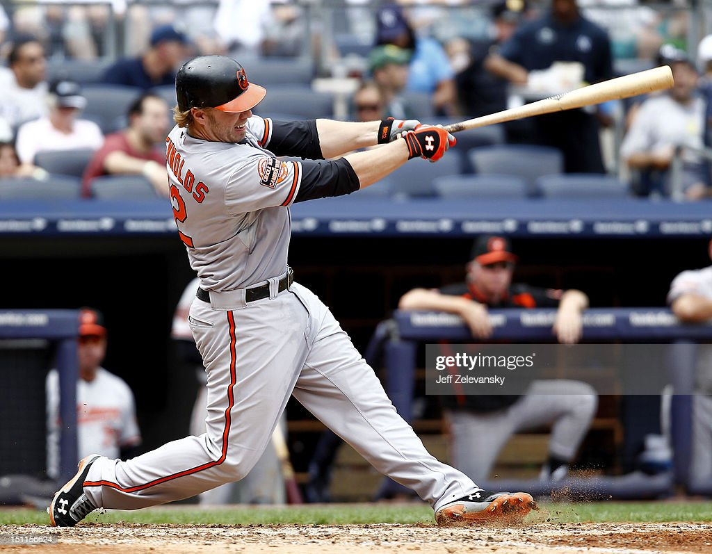 Mark Reynolds #12 of the Baltimore Orioles hits a three-run home run against the New York Yankees at Yankee Stadium on September 2, 2012 in the Bronx borough of New York City.