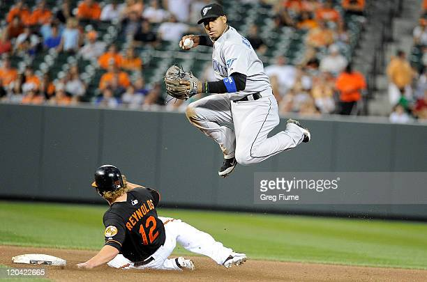 Mark Reynolds of the Baltimore Orioles is forced out at second base by Yunel Escobar of the Toronto Blue Jays at Oriole Park at Camden Yards on...