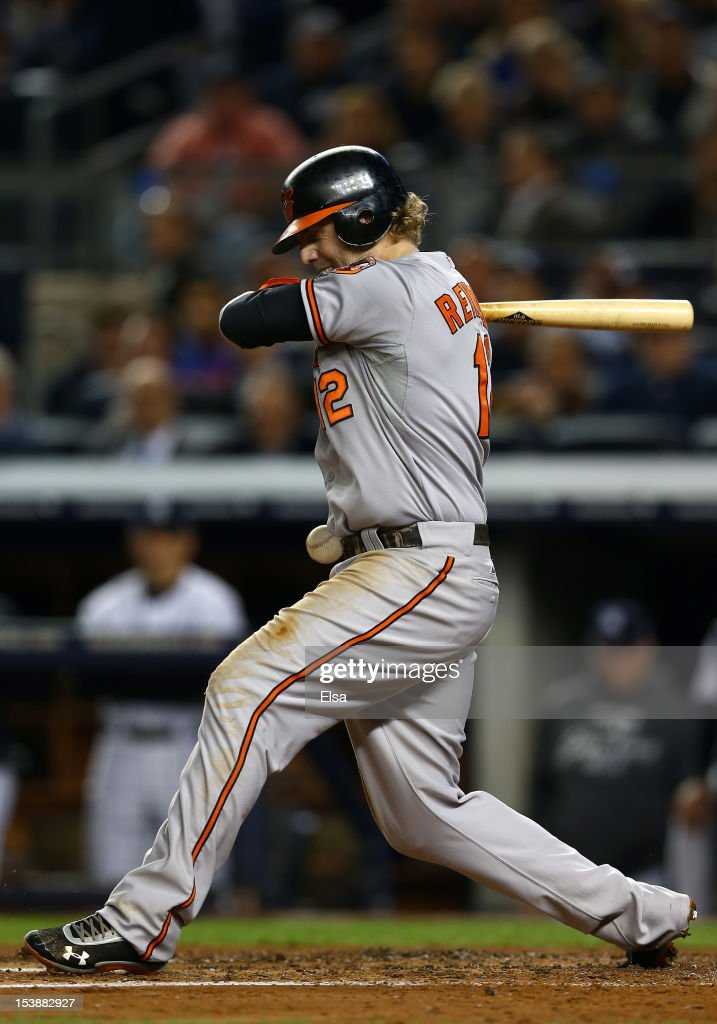 Mark Reynolds #12 of the Baltimore Orioles is hit by a pitch during Game Three of the American League Division Series against the New York Yankees at Yankee Stadium on October 10, 2012 in the Bronx borough of New York City.