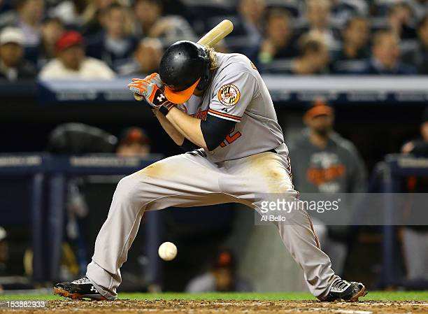 Mark Reynolds of the Baltimore Orioles is hit by a pitch during Game Three of the American League Division Series against the New York Yankees at...