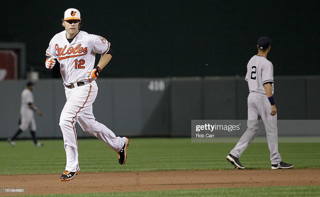 <a gi-track='captionPersonalityLinkClicked' href=/galleries/search?phrase=Mark+Reynolds&family=editorial&specificpeople=2343799 ng-click='$event.stopPropagation()'>Mark Reynolds</a> #12 of the Baltimore Orioles rounds the bases after hitting a two RBI home run against the New York Yankees during the eighth inning of the Orioles 10-6 win at Oriole Park at Camden Yards on September 6, 2012 in Baltimore, Maryland.