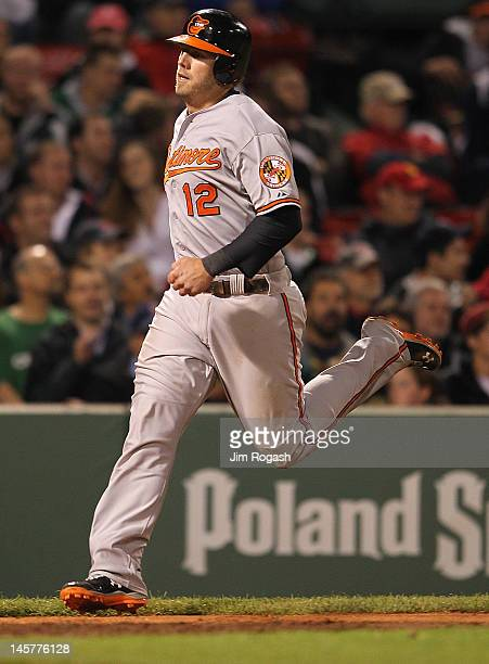 Mark Reynolds of the Baltimore Orioles scores the winning on a hit by Ronny Paulino of the Baltimore Orioles in the ninth inning against the Boston...