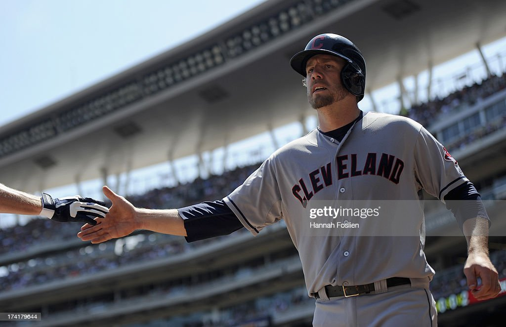 <a gi-track='captionPersonalityLinkClicked' href=/galleries/search?phrase=Mark+Reynolds&family=editorial&specificpeople=2343799 ng-click='$event.stopPropagation()'>Mark Reynolds</a> #12 of the Cleveland Indians celebrates scoring a run against the Minnesota Twins during the second inning of the game on July 21, 2013 at Target Field in Minneapolis, Minnesota.