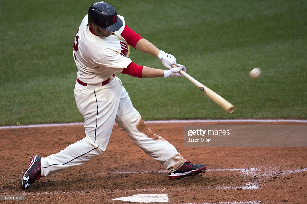 <a gi-track='captionPersonalityLinkClicked' href=/galleries/search?phrase=Mark+Reynolds&family=editorial&specificpeople=2343799 ng-click='$event.stopPropagation()'>Mark Reynolds</a> #12 of the Cleveland Indians hits a grand slam during the fifth inning against the Chicago White Sox at Progressive Field on April 13, 2013 in Cleveland, Ohio.