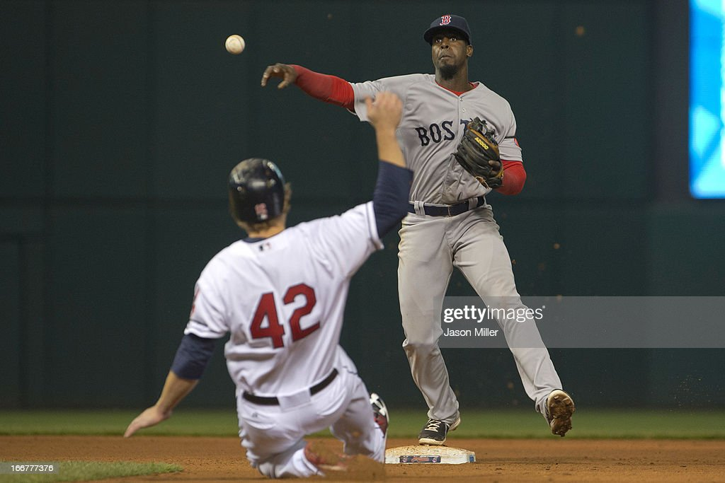 <a gi-track='captionPersonalityLinkClicked' href=/galleries/search?phrase=Mark+Reynolds+-+Baseball+Player&family=editorial&specificpeople=2343799 ng-click='$event.stopPropagation()'>Mark Reynolds</a> of the Cleveland Indians is out at second as shortstop <a gi-track='captionPersonalityLinkClicked' href=/galleries/search?phrase=Pedro+Ciriaco&family=editorial&specificpeople=5718591 ng-click='$event.stopPropagation()'>Pedro Ciriaco</a> of the Boston Red Sox throws to first for a double play during the eighth inning at Progressive Field on April 16, 2013 in Cleveland, Ohio. All uniformed team members are wearing jersey number 42 in honor of Jackie Robinson Day.