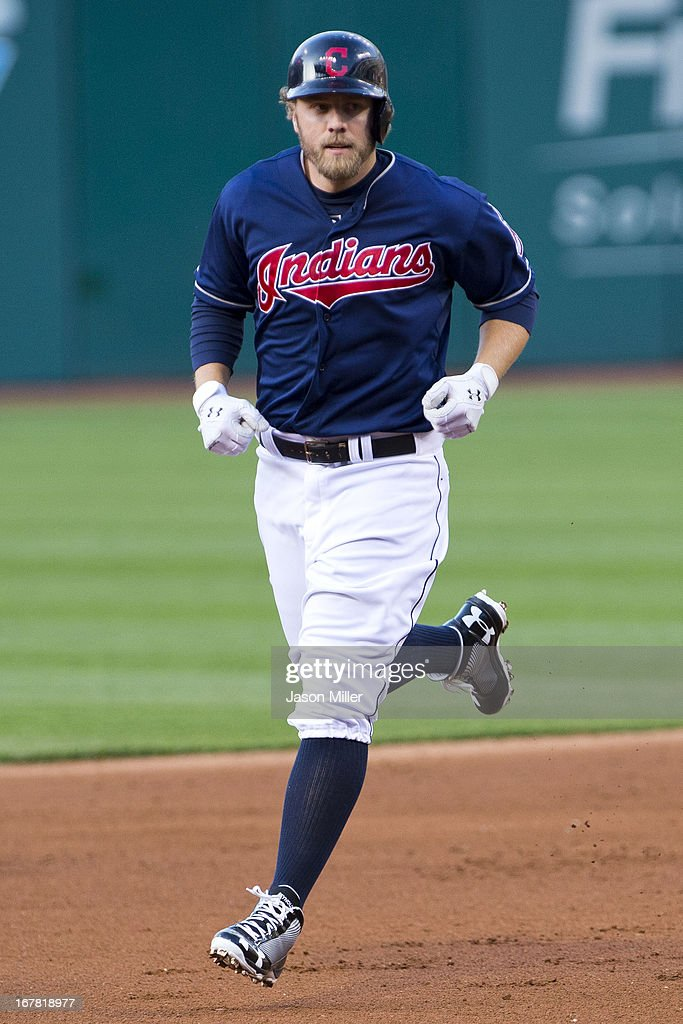 <a gi-track='captionPersonalityLinkClicked' href=/galleries/search?phrase=Mark+Reynolds&family=editorial&specificpeople=2343799 ng-click='$event.stopPropagation()'>Mark Reynolds</a> #12 of the Cleveland Indians rounds the bases after hitting a two run home run during the first inning against the Philadelphia Phillies at Progressive Field on April 30, 2013 in Cleveland, Ohio.
