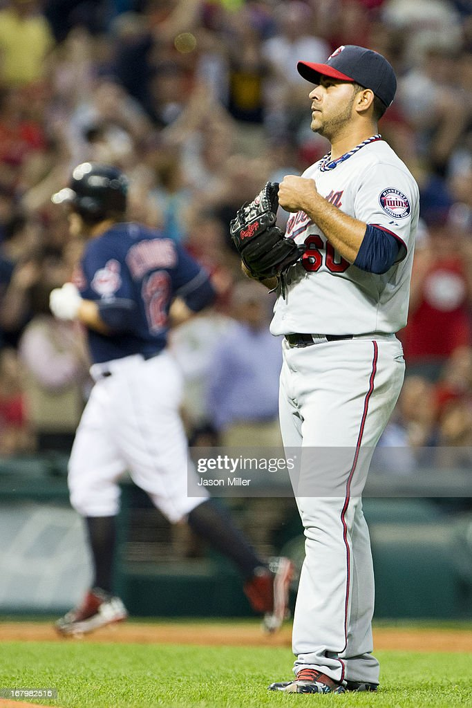 <a gi-track='captionPersonalityLinkClicked' href=/galleries/search?phrase=Mark+Reynolds&family=editorial&specificpeople=2343799 ng-click='$event.stopPropagation()'>Mark Reynolds</a> #12 of the Cleveland Indians rounds the bases after hitting a two run home run during the fifth inning against starting pitcher Pedro Hernandez #60 of the Minnesota Twins at Progressive Field on May 3, 2013 in Cleveland, Ohio.