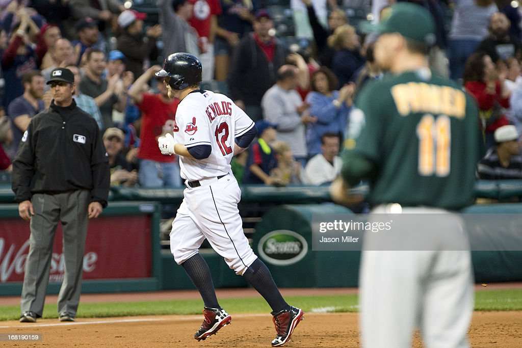 <a gi-track='captionPersonalityLinkClicked' href=/galleries/search?phrase=Mark+Reynolds&family=editorial&specificpeople=2343799 ng-click='$event.stopPropagation()'>Mark Reynolds</a> #12 of the Cleveland Indians rounds the bases after hitting a solo home run during the fifth inning against starting pitcher <a gi-track='captionPersonalityLinkClicked' href=/galleries/search?phrase=Jarrod+Parker&family=editorial&specificpeople=5970942 ng-click='$event.stopPropagation()'>Jarrod Parker</a> #11 of the Oakland Athletics at Progressive Field on May 6, 2013 in Cleveland, Ohio.