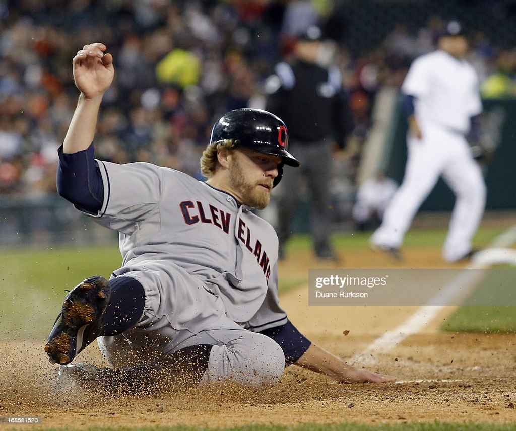 <a gi-track='captionPersonalityLinkClicked' href=/galleries/search?phrase=Mark+Reynolds&family=editorial&specificpeople=2343799 ng-click='$event.stopPropagation()'>Mark Reynolds</a> #12 of the Cleveland Indians scores against the Detroit Tigers from second base on a single by Mike Aviles at Comerica Park on May 11, 2013 in Detroit, Michigan.