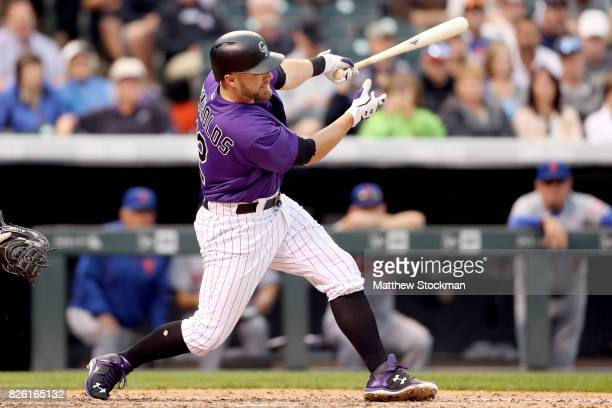 Mark Reynolds of the Colorado Rockies hits a home run in the sixth inning against the New York Mets at Coors Field on August 3 2017 in Denver Colorado