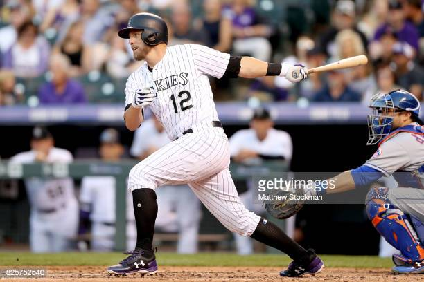Mark Reynolds of the Colorado Rockies hits a RBI single in the third inning against the New York Mets at Coors Field on August 2 2017 in Denver...