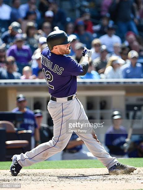 Mark Reynolds of the Colorado Rockies hits a single during the ninth inning of a baseball game against the San Diego Padres at PETCO Park on May 4...