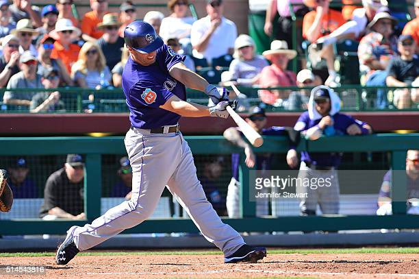 Mark Reynolds of the Colorado Rockies hits an RBI single in the fifth inning against the San Francisco Giants during the spring training game at...