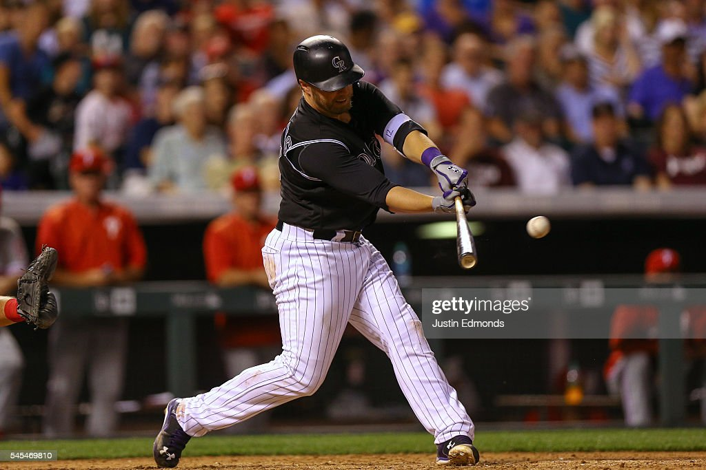 Mark Reynolds #12 of the Colorado Rockies hits an three RBI double during the seventh inning against the Philadelphia Phillies at Coors Field on July 7, 2016 in Denver, Colorado.
