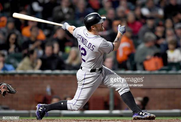 Mark Reynolds of the Colorado Rockies swings and watches the flight of his ball as he hits a threerun homer against the San Francisco Giants in the...
