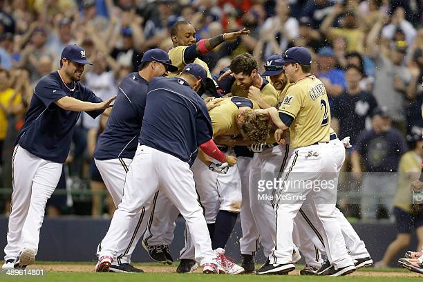 Mark Reynolds of the Milwaukee Brewers celebrates with his team after hitting a walk off single in the bottom of the ninth inning against the New...