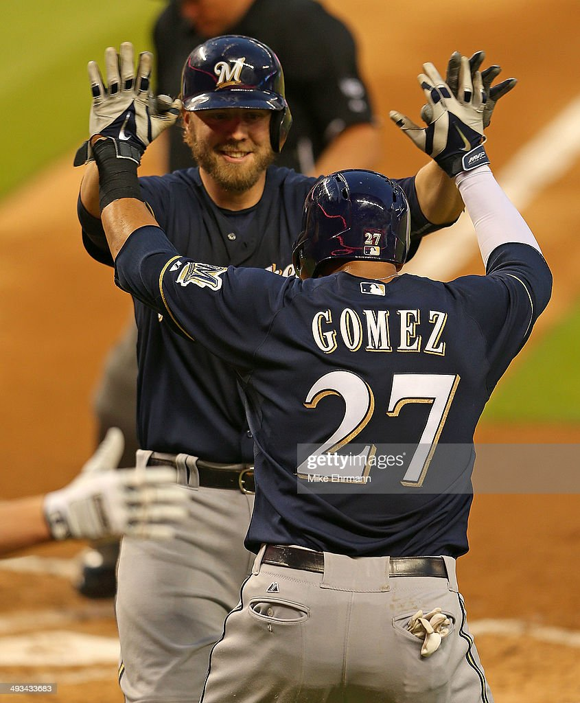 <a gi-track='captionPersonalityLinkClicked' href=/galleries/search?phrase=Mark+Reynolds&family=editorial&specificpeople=2343799 ng-click='$event.stopPropagation()'>Mark Reynolds</a> #7 of the Milwaukee Brewers is congratulated by Carlos Gomez #27 after hitting a two run home run during a game against the Miami Marlins at Marlins Park on May 23, 2014 in Miami, Florida.