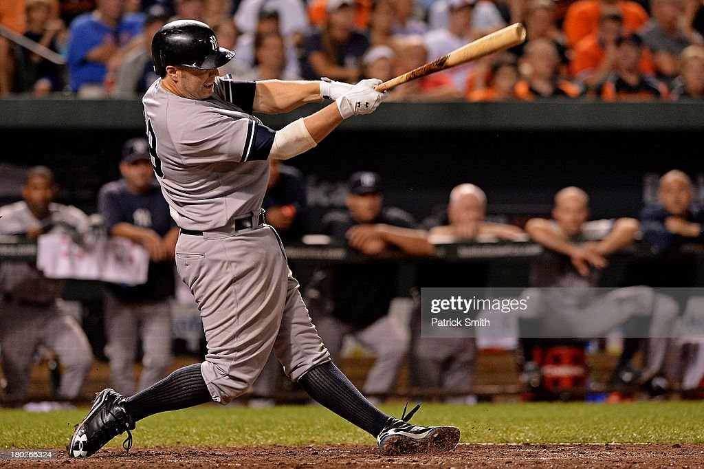 Mark Reynolds #39 of the New York Yankees hits a double against the Baltimore Orioles in the eighth inning at Oriole Park at Camden Yards on September 10, 2013 in Baltimore, Maryland.